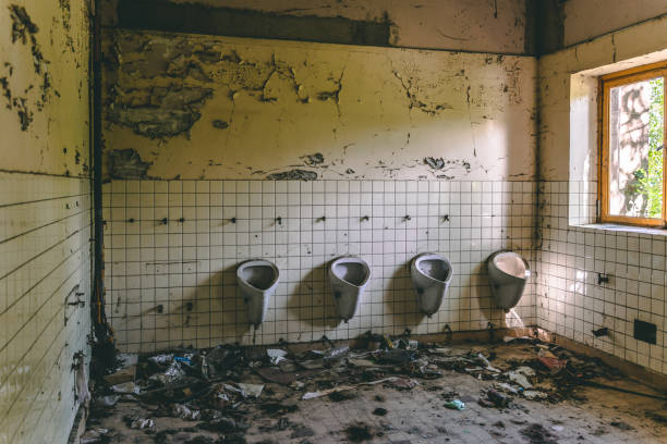 Old abandoned bathroom in a school stock photo