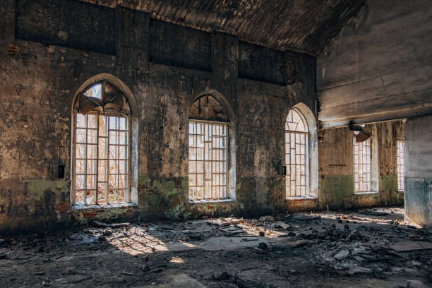 Old abandoned building with broken lancet windows inside Old abandoned building with broken lancet windows inside, Ramon, Voronezh Region, Russia lancet arch stock pictures, royalty-free photos & images