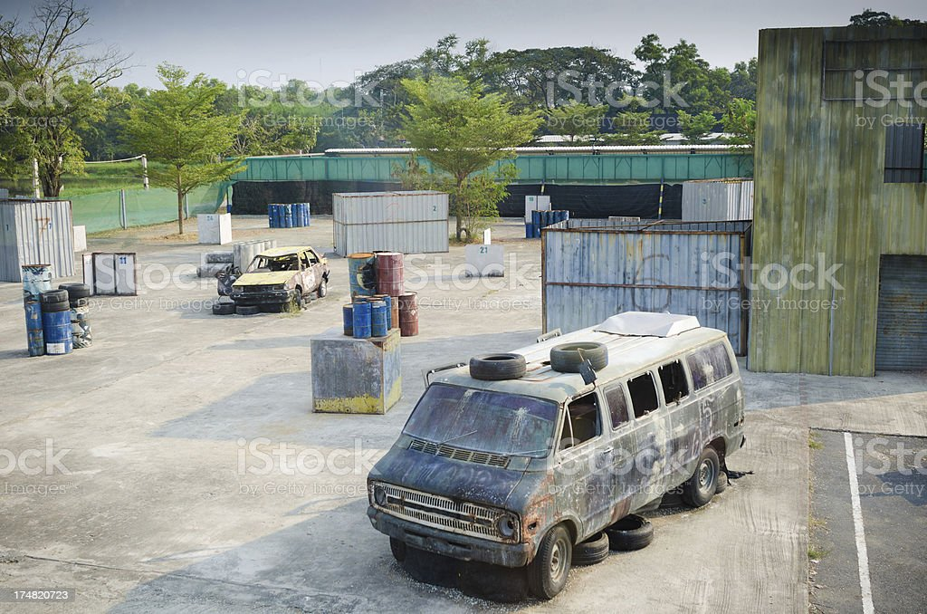 Old abandoned car in a paint ball court royalty-free stock photo