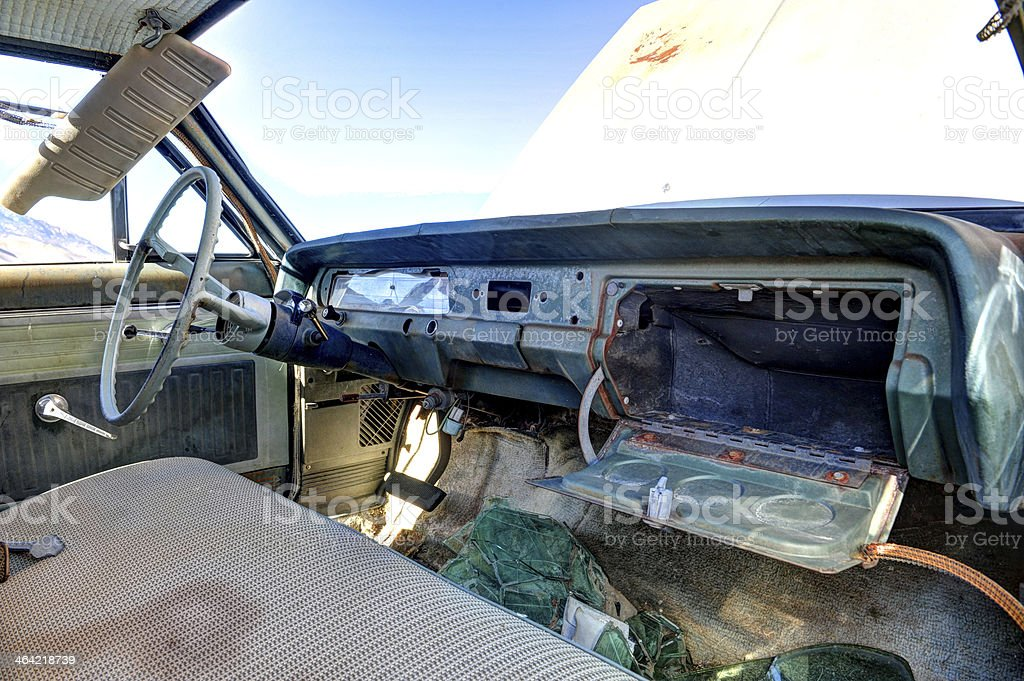 Old abandoned car interior with open glove box stock photo