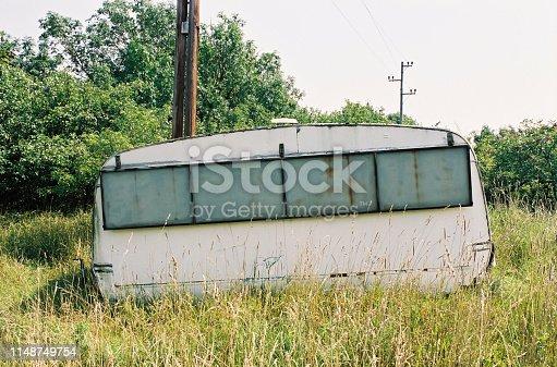 Old abandoned caravan in green nature