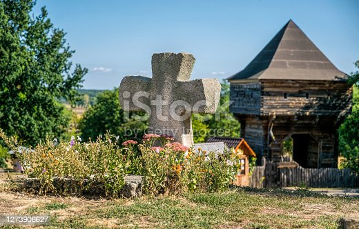 istock Old abandoned cemetery and ancient tower 1273906627