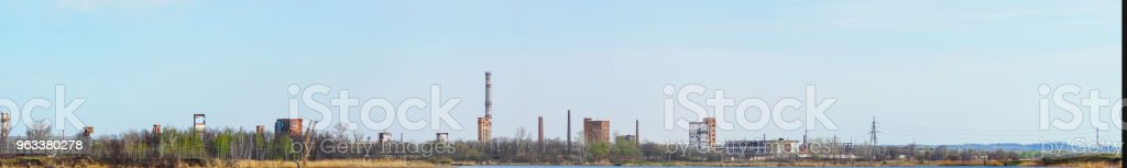 Old Abandoned chemical factory with chimneys on the banks of the river - Zbiór zdjęć royalty-free (Apokalipsa)