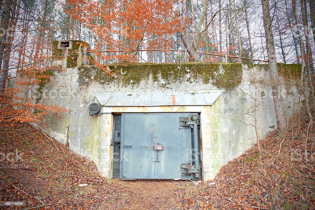 Old abandoned Cold War bunker in forest. stock photo