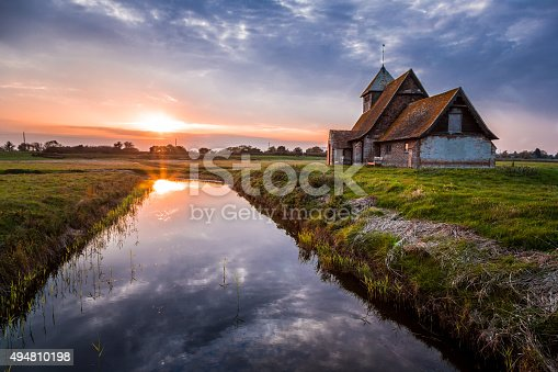 istock Old Abandoned Country Church at Sunset with River Reflection 494810198