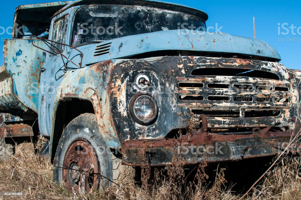 Old abandoned dirty broken vintage truck stock photo