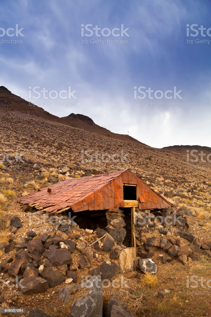 Old abandoned dugout with tin roof at the Ghost Town of Candelaria in Nevada. stock photo
