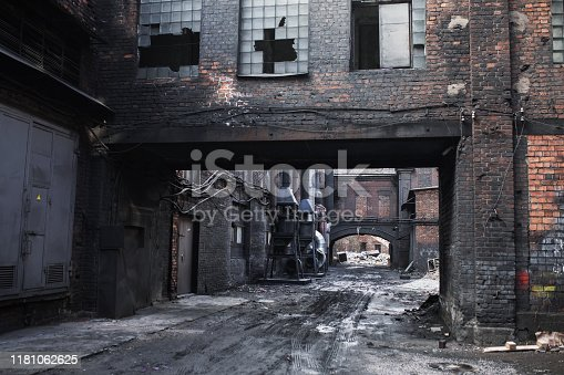 Old abandoned factory. Gothic background. Scary place. Post apocalyptic landscape. Halloween party place. Abandoned buiding. Industrial background