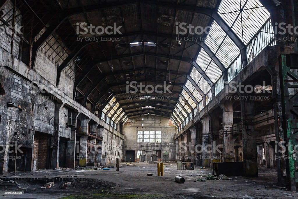 Old abandoned factory hall, industrial background stock photo
