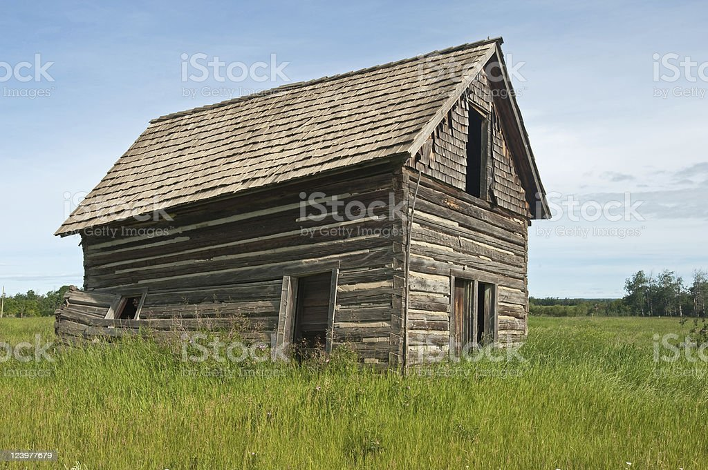 Old abandoned farm building:  decayed log barn royalty-free stock photo