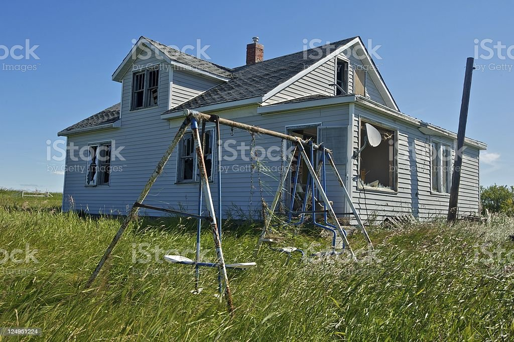 Old abandoned farm building: house with swing royalty-free stock photo