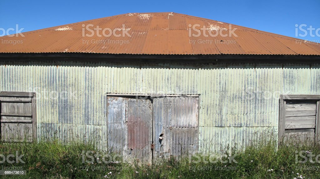 Old abandoned farm facade stock photo