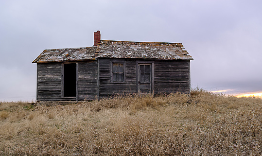 istock Old Abandoned Farm House on the Prairie 1066242424