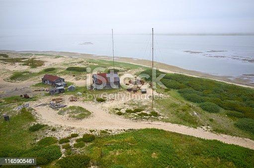 Old abandoned farmhouse, Piltun bay coast, the north of Sakhalin island, Russia. Sea of Okhotsk