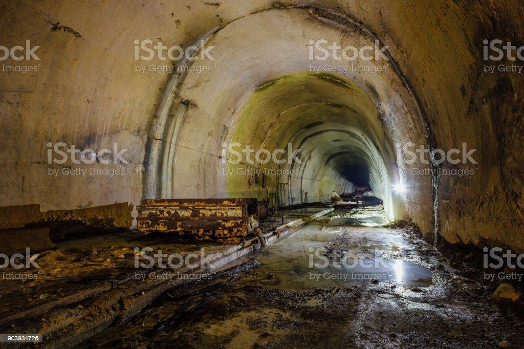 Old abandoned flooded drainage tunnel stock photo