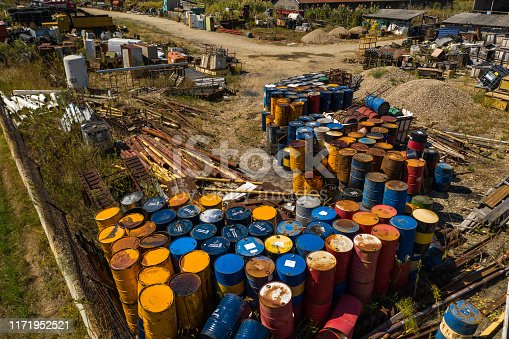 Colorful metal  barrels on abandoned junk yard, high angle  view