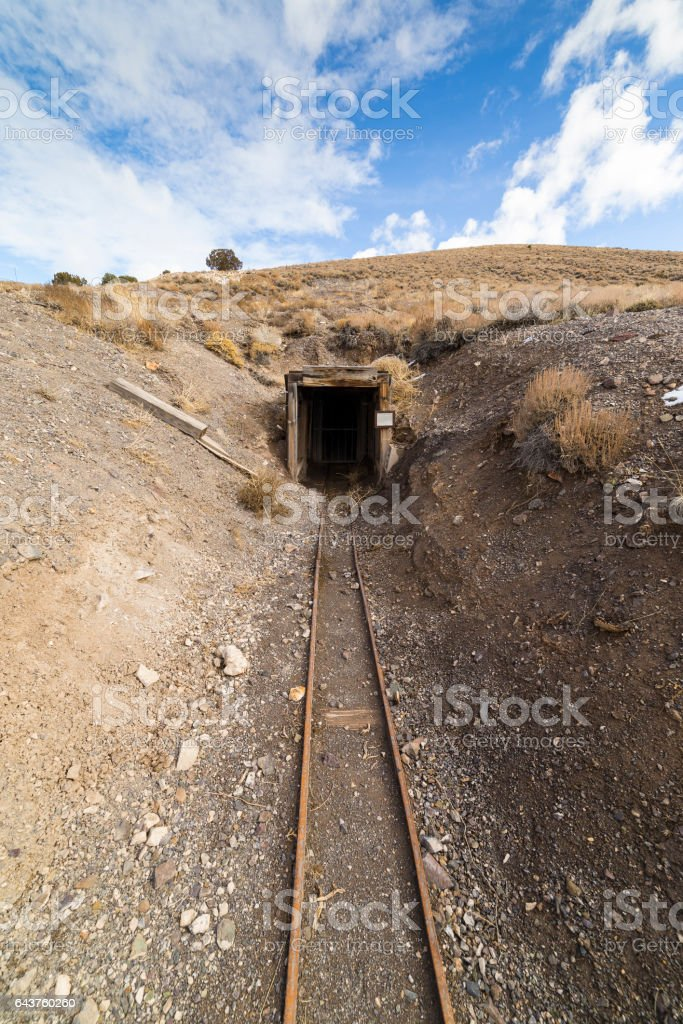Old abandoned gold mine entrance in the Nevada desert near ghost town. stock photo