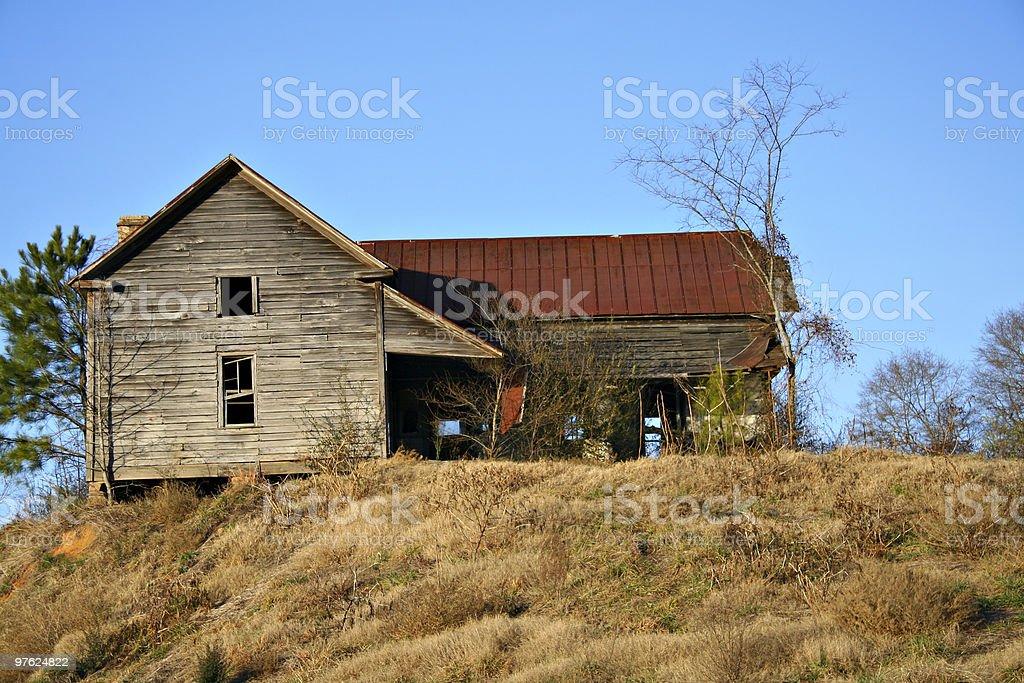 Old abandoned house on hill royaltyfri bildbanksbilder