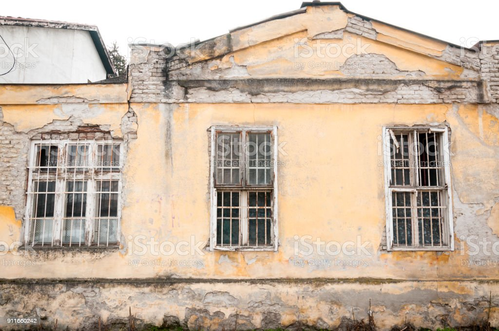 Old abandoned house with gratings on the windows used as police station and prison during world war two by Nazi Germans and Hungarians for civilians stock photo