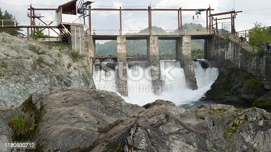 istock Old abandoned hydroelectric Chemal in the Altai region in Russia 1180930712