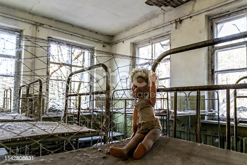 Consequences of the Chernobyl nuclear disaster. Bedroom in the room of the old kindergarten. Broken beds and forgotten toys. Desolation and devastation in the exclusion zone and radiation pollution