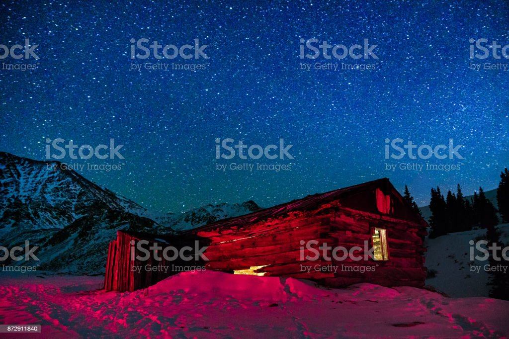 Old Abandoned Mining Buildings and Starry Milky Way Stars stock photo