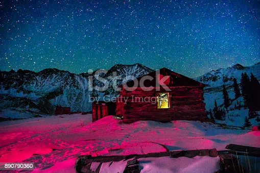 Old Abandoned Mining Buildings and Starry Milky Way Stars - Old cabins and night sky with stars and winter mountain view.