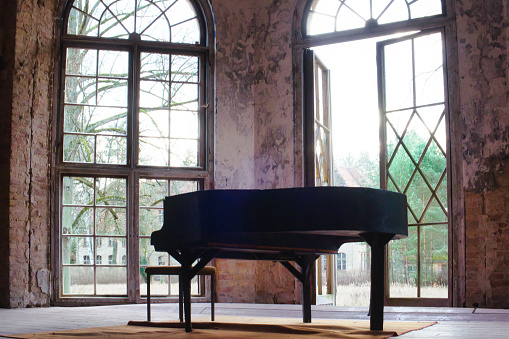 Old abandoned piano in the ruins