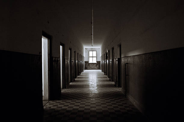 Old Abandoned Prision Corridor The corridor of an old abandoned prison derelict stock pictures, royalty-free photos & images