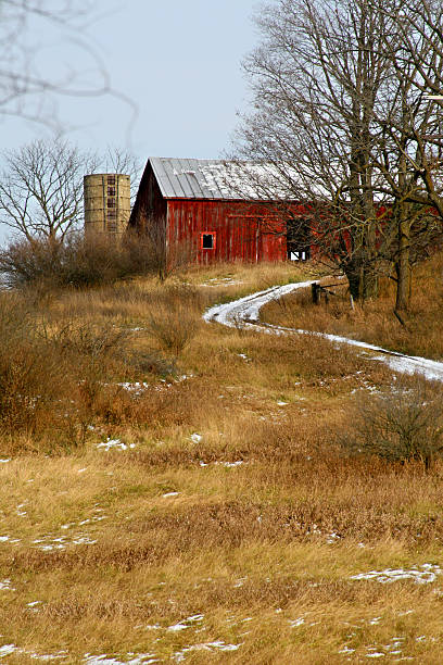 Old Abandoned Red Barn on Winding Path in West Michigan stock photo