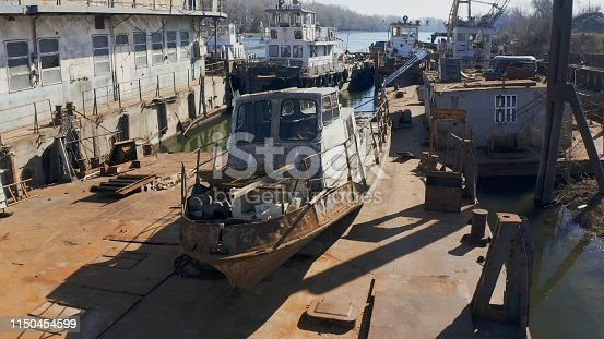 Old abandoned river port with rusty ships