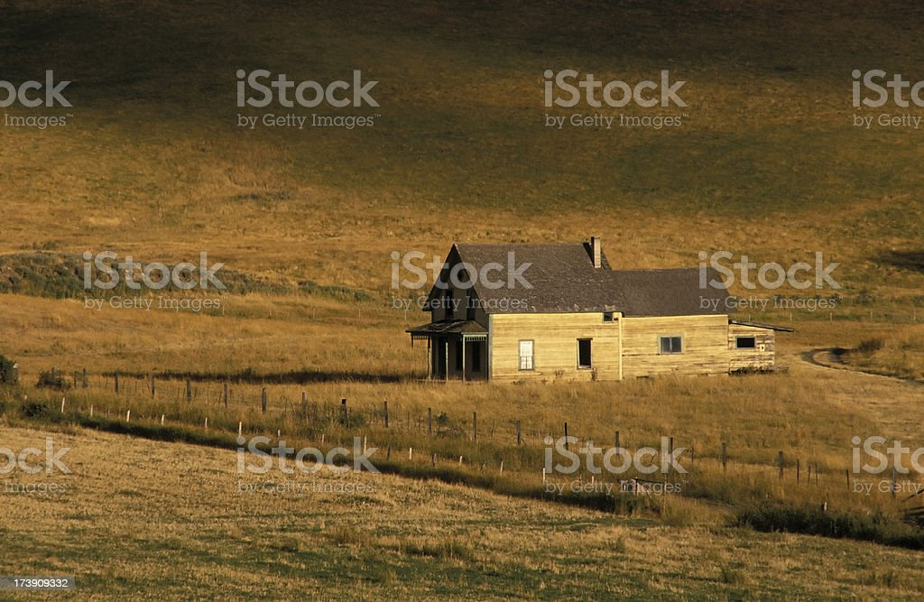 old abandoned rustic farm house rural field weathered royalty-free stock photo