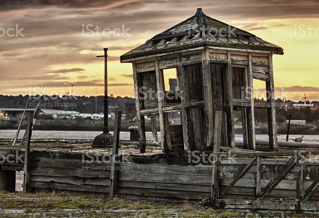 Old abandoned shack by Mersey royalty-free stock photo