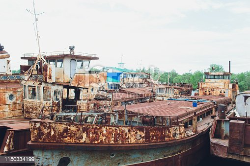 Old abandoned ship on the river bank
