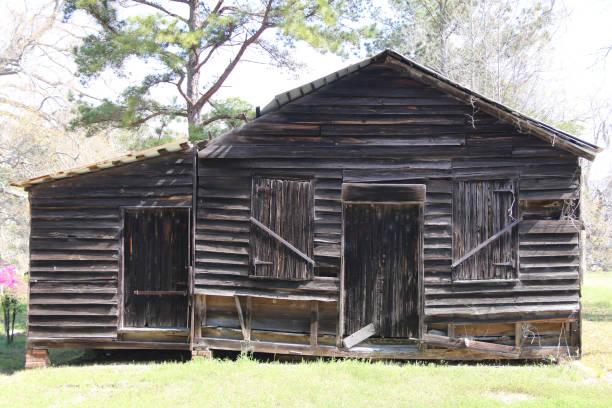 old abandoned southern style farm barn sunny shadows stock photo