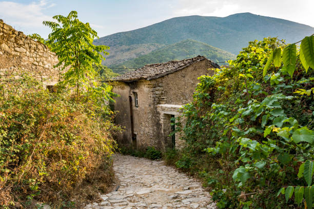 Old abandoned stone-built houses in Old Perithia at Pantokrator Mountain, Corfu Island, Greece stock photo
