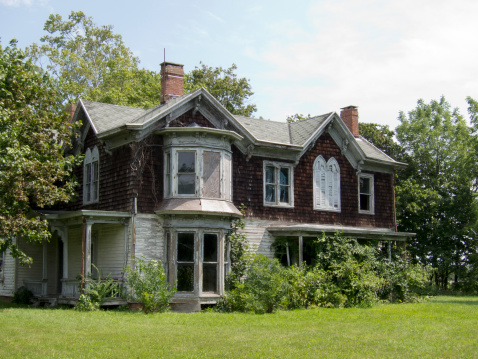 An old abandoned Victorian farmhouse.