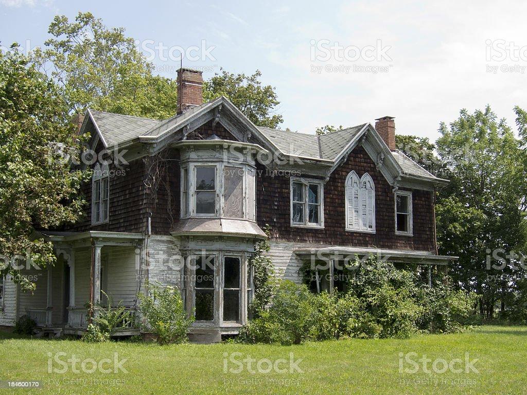 Old Abandoned Victorian Farmhouse stock photo