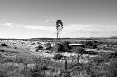 Abandoned windmill water pump on farmland in the Karoo South Africa
