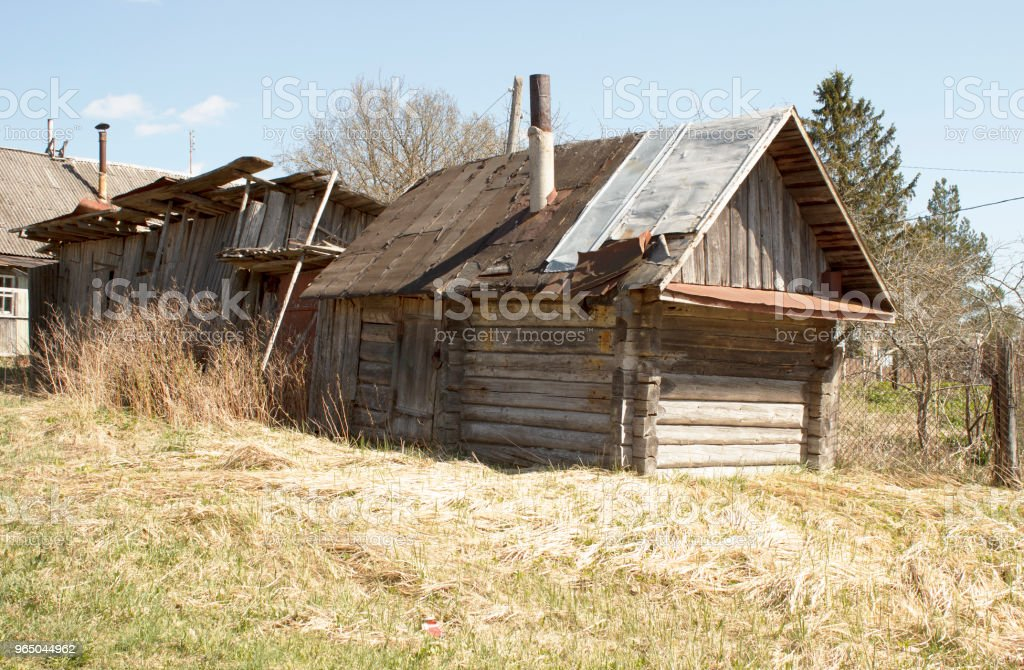 Old abandoned wooden house with a pipe. Spring royalty-free stock photo