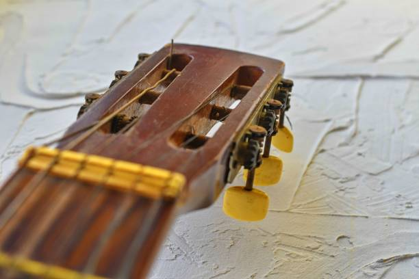 Old acoustic guitar head with tuning pegs. Copy space. stock photo