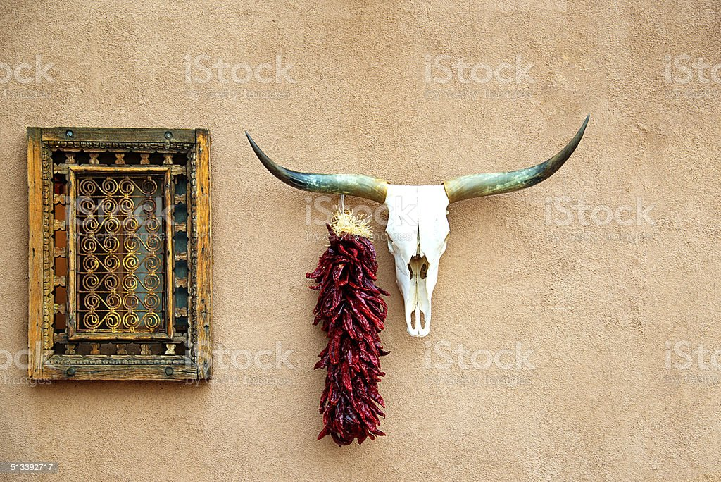 Old Adobe House, Animal Skull and Hanging Chili Peppers  Ristra stock photo