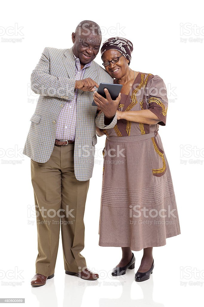 Antigua pareja africana usando tableta - foto de stock