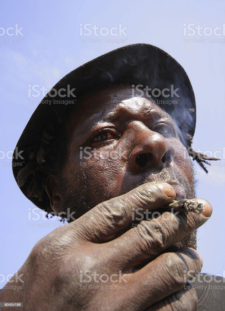 Old African Man Smoking three royalty-free stock photo