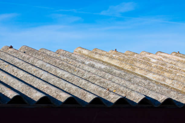 Old aged dangerous asbestos roof made of concrete panels - one of the most dangerous materials in buildings so-called