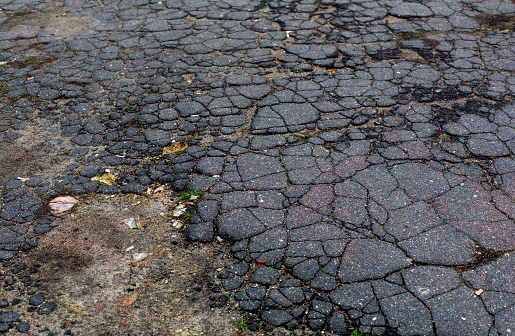 Old Aged Grey Cracked Asphalt Road Surface Stock Photo - Download Image Now