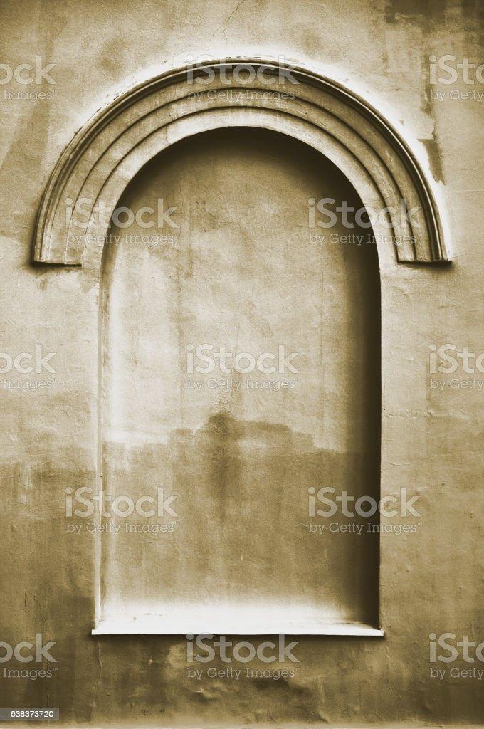 Old aged plastered faux arch false fake window stucco frame stock photo