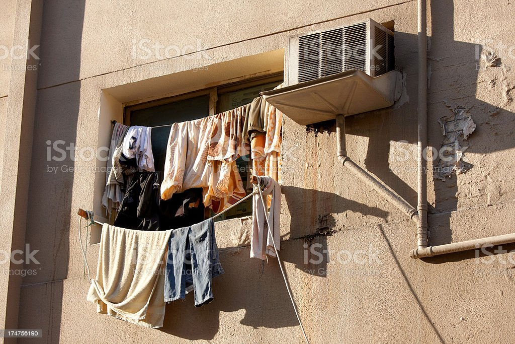 Old Airconditioner beside washed cloth stock photo