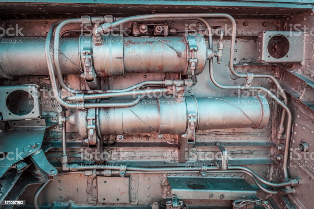 Old aircraft engine closeup with rusty decaying metal pipes and bolts stock photo