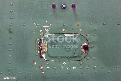 487808089 istock photo Old aircraft green hatch with rivets. 1226371477